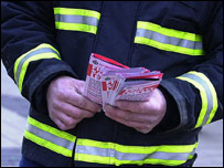 A firefighter hands out leaflets - generic