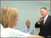 First Minister Jack McConnell chat to patient Angela Conner during a visit to  Glasgow's Southern General Hospital