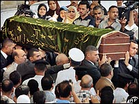 Naguib Mahfouz's coffin is carried from al-Hussein mosque in Cairo