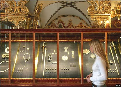 A woman looks at precious objects in the Jewel Room of the Green Vault.