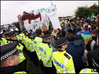 A line of police and protestors at Drax