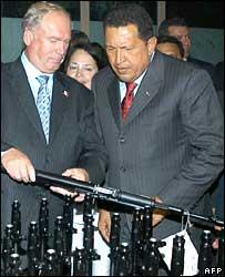 Hugo Chavez (r) inspects Kalashnikov assault rifles in Russia