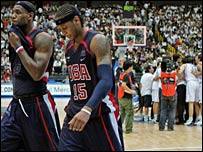 LeBron James (left) and Carmelo Antony leave the court as the Greeks celebrate