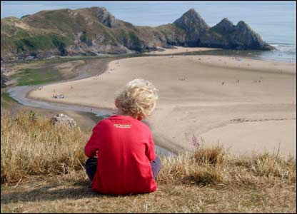 Christopher West's grandson Dominic, on holiday camping overlooking Three Cliffs Bay, Gower