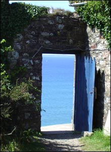 A door in a walled garden looking over Druidstone Bay, Pembrokeshire (Vitti Allender)