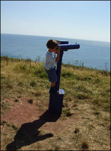 Lewis Jones took this picture of his son Gwyn looking out to open sea with the telescope at Caldey lighthouse