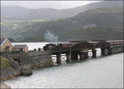 The last steam train of the summer season, on the Cambrian Coast railway, approaches Barmouth over the Barmouth Bridge (Alan Vincent)