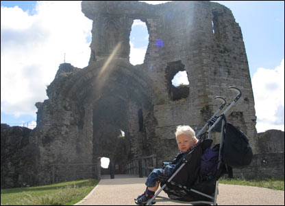Simon Adey-Davies' youngest son Osian outside Denbigh Castle
