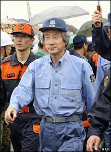 Japanese Prime Minister Junichiro Koizumi inspects the anti-disaster drill in Tokyo