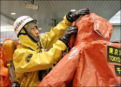 Tokyo firefighters don anti-chemical and biological suits to join in the exercise