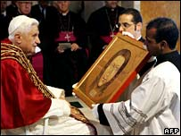 Pope Benedict XVI receives a reproduction of the Veil of Veronic