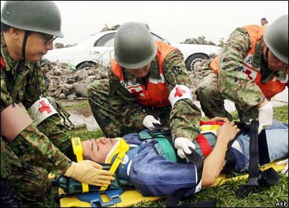 Medical workers from the Self Defence Force treat a mock injured man