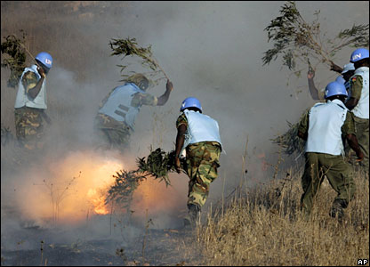 Ghanaian peacekeepers putting out a fire in Lebanon