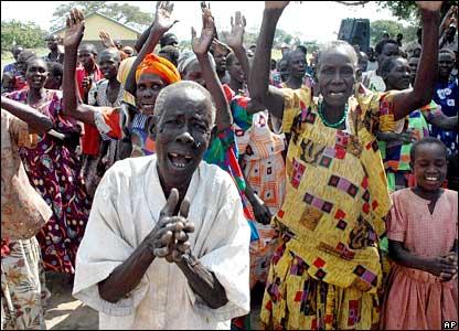 Displaced Ugandans cheering