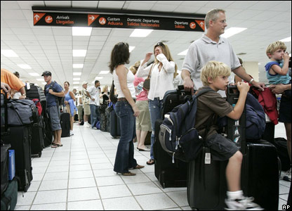 Tourists wait at the airport in San Jose del Cabo, Mexico.