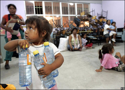 A little girl collects water bottles in a hurricane shelter in Cabo San Lucas, Mexico.