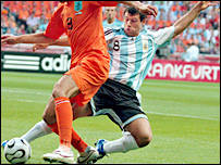 Javier Mascherano (r) in action against at the World Cup