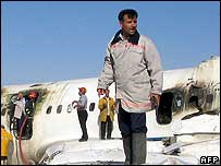 Emergency services at the wreck of the airliner at Mashhad