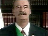 Mexican President Vicente Fox makes a TV address after being forced out of Congress on Friday