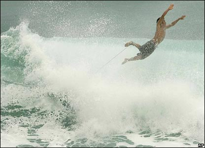 A boy bails off his surfboard while sailing off Cabo San Lucas on 1 Sep