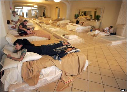 US tourists rest in a temporary shelter in Cabo San Lucas