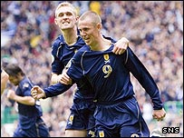 Kenny Miller and Darren Fletcher celebrate at Celtic Park