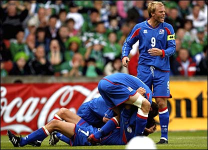 Hermann Hreidarsson is mobbed after scoring