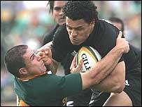 South Africa match-winner Andre Pretorius stops All Blacks's full-back Doug Howlett