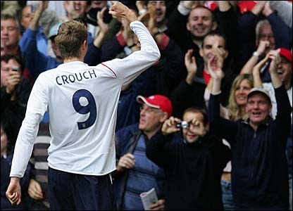 Peter Crouch celebrates opening the scoring for England