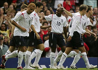 Jermain Defoe is congratulated by his England team-mates