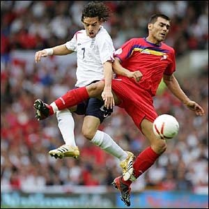 Owen Hargreaves beats Andorra's Fernando Jose Silva to the ball