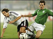 Torsten Frings of Germany and Kevin Kilbane of the Republic of Ireland