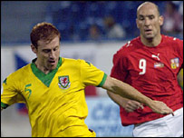 Wales defender James Collins tussles with Czech striker Jan Koller