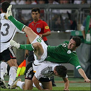 Republic of Ireland's Robbie Keane takes a tumble against Germany