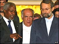 UN Secretary General Kofi Annan, left, with Iranian nuclear negotiator Ali Larijani, right
