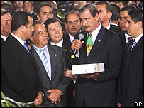 Vicente Fox hands his speech to Congress