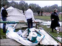The collapsed tent and debris