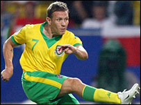 Craig Bellamy watches his shot hit the post in Teplice