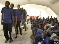 Migrants queue up in a Red Cross tent in Los Cristianos in Tenerife