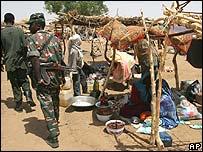 Sudanese soldiers patrol a Darfur village