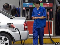 Man filling up car at petrol station in Beijing