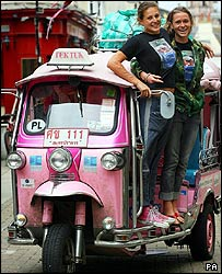 Jo Huxster (left) and Antonia Bolingbroke-Kent in front of their pink tuk-tuk