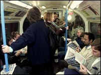 Commuters reading metro