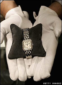 "A Cartier 18K white gold and diamond ""Panthere"" wristwatch."