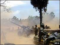Soldiers fire artillery shells at rebel positions on the Jaffna peninsula