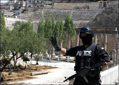 Jordanian anti-terrorism police control access to Amman's Roman amphitheatre