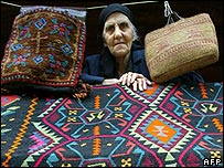 Georgian woman selling carpets and bags in Tbilisi