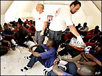 Migrantes reciben ayuda en España