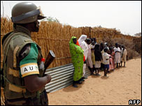 An African Union soldier stands guard in the village of Gos Beina during an AU patrol south of the town of al-Fasher in Darfur 10 June 2006