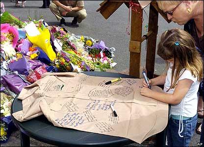 Girl signing Steve Irwin's shirt